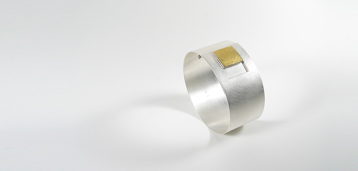 zilveren-armband-gecombineerd-met-goud-18-krt.jpg